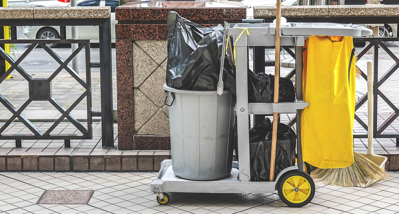 Janitorial Cart holding trash, map & broom